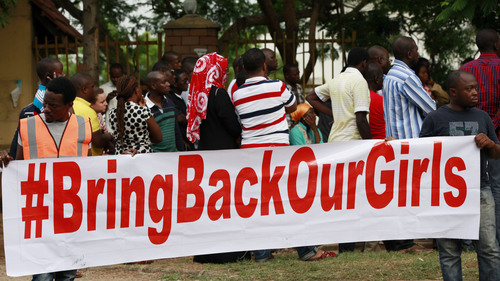 """People attend a rally calling on the Government to rescue the school girls kidnapped from the Chibok Government secondary school, in Abuja, Nigeria, Saturday May 10, 2014. The president of Nigeria for weeks refused international help to search for more than 300 girls abducted from a school by Islamic extremists, one in a series of missteps that have led to growing international outrage against the government. The waiting has left parents in agony, especially since they fear some of their daughters have been forced into marriage with their abductors for a nominal bride price of $12. Boko Haram leader Abubakar Shekau called the girls slaves in a video this week and vowed to sell them. """"For a good 11 days, our daughters were sitting in one place,"""" said Enoch Mark, the anguished father of two girls abducted from the Chibok Government Girls Secondary School. """"They camped them near Chibok, not more than 30 kilometers, and no help in hand. For a good 11 days."""" (AP Photo/Sunday Alamba)"""