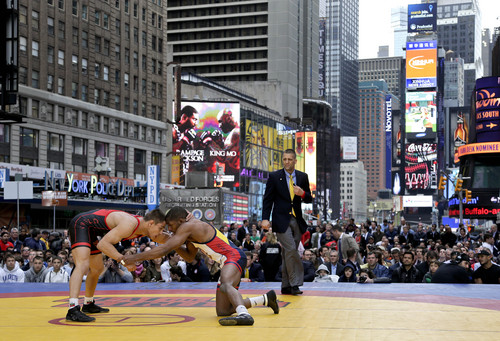 Team USA's Nahshon Garrett, left, grapples for leverage against Russia's Georgi Vangelov during an exhibition wrestling match in Times Square, Wednesday, May 7, 2014, in New York. Wrestlers competing in the exhibition included past and potential future Olympic athletes from the USA, Russia, Bulgaria, Venezuela and Canada. (AP Photo/Julie Jacobson)
