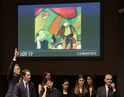 Bid takers cast bids from buyers over the phone for the painting, Strandszene, by Wassily Kandinsky during an impressionist and modern art auction at Christie's, Tuesday, May 6, 2014, in New York. The auction house says it expects to raise over $245 million from the sale of works including those by Monet, Renoir, Picasso, Degas, Matisse and Kandinsky. (AP Photo/Julie Jacobson)