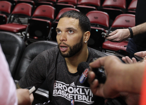 Brooklyn Nets guard Deron Williams talks with the media during the teams basketball practice on Wednesday, May 7, 2014 in Miami.  The Nets will face the Miami Heat in game 2 of the Eastern Conference semifinal series in Miami.  (AP Photo/El Nuevo Herald, David Santiago)  MAGS OUT