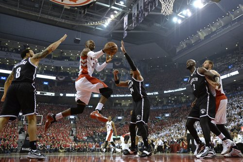 Toronto Raptors' Terrence Ross (31) drives to the net against Brooklyn Nets' Deron Williams (8) and Paul Pierce (34) as Nets' Kevin Garnett (2) boxes out Raptors' Jonas Valanciunas during the first half of Game 7 of the opening-round NBA basketball playoff series in Toronto, Sunday, May 4, 2014. (AP Photo/The Canadian Press, Frank Gunn)