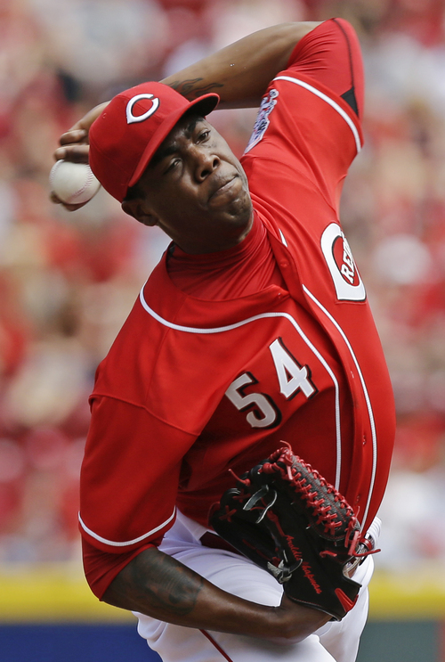 Cincinnati Reds relief pitcher Aroldis Chapman throws against the Colorado Rockies in the ninth inning of a baseball game, Sunday, May 11, 2014, in Cincinnati. Chapman earned his first save of the year as the Reds won 4-1. Chapman was making his first appearance since being hit in the head with a line drive in spring training. (AP Photo/Al Behrman)