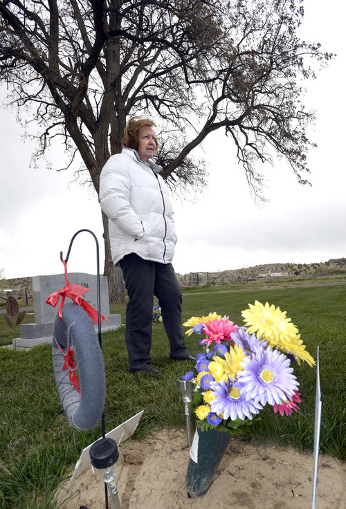 Al Hartmann  |  The Salt Lake Tribune Midwife Donna looks at a grave marker of a stillborn child in Rock Point Cemetery in Maeser just north of Vernal.  She started noticing a higher than usual amounts of stillborn and newborn deaths in the area the past few years.  One corner of the cemetery has several small markers for stillborn and newborn  deaths.     The TriCounty Health Department is holding a public meeting Wednesday May 7 to investigate the uptick in stillbirths and newborn deaths in the area. Environmentalists believe there's a connection to air pollution from oil and gas drilling.