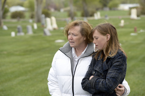 Al Hartmann  |  The Salt Lake Tribune Midwife Donna Young and her daughter Holt, look at a grave markers of stillborn and newborn children in Rock Point Cemetery in Maeser just north of Vernal.  She started noticing a higher than usual amounts of stillborn and newborn deaths in the area the past few years.  One corner of the cemetery has several small markers for stillborn and newborn  deaths.      The TriCounty Health Department is holding a public meeting Wednesday May 7 to investigate the uptick in stillbirths and newborn deaths in the area. Environmentalists believe there's a connection to air pollution from oil and gas drilling.