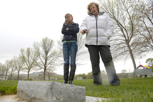 Al Hartmann  |  The Salt Lake Tribune Midwife Donna Young and her daughter Holt, look at a grave marker of a stillborn child in Rock Point Cemetery in Maeser just north of Vernal.  She started noticing a higher than usual amounts of stillborn and newborn deaths in the area the past few years.  One corner of the cemetery has several small markers for stillborn and newborn  deaths.     The TriCounty Health Department is holding a public meeting Wednesday May 7 to investigate the uptick in stillbirths and newborn deaths in the area. Environmentalists believe there's a connection to air pollution from oil and gas drilling.