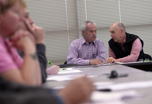 Al Hartmann  |  The Salt Lake Tribune Ron Winterton, left, and Kirk Wood, Duchesne County Commissioners, discuss ideas at the TriCounty Health Department meeting Wednesday May 7 in Vernal.   Local officials, health care workers and citizens met to craft an investigation into the uptick in stillbirths and newborn deaths in the area.
