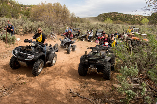 Trent Nelson  |  The Salt Lake Tribune ATV riders cross into a restricted area of Recapture Canyon, which has been closed to motorized use since 2007. The protest on Saturday, May 10, 2014, north of Blanding, came after a call-to-action by San Juan County Commissioner Phil Lyman.