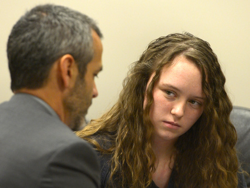 Rick Egan  |  The Salt Lake Tribune  Defense attorney's Rhome Zabriskie talks with Meagan Grunwald, a teen charged in connection with fatal officer shooting in Utah County, during a recess in her preliminary hearing in Judge Darold McDade's courtroom in Provo Thursday April 17, 2014