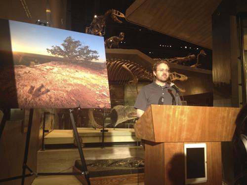 Brett Prettyman  |  The Salt Lake Tribune Randall Irmis, curator of paleontology at the Natural History Museum of Utah, talks about the significance of a story on Utah dinosaur digs in National Geographic.