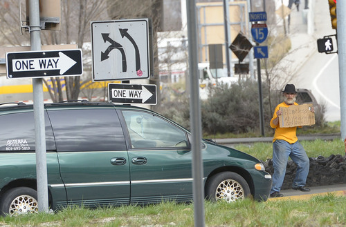 Leah Hogsten  |  Tribune file photo HB101, one of several new laws that go into effect Tuesday, bans panhandling along state highways, freeways and their shoulders -- but not on public sidewalks.