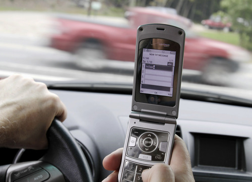 Pat Wellenbach  |  AP file photo A new Utah law that goes into effect Tuesday prohibits texting or dialing a telephone while driving, but still allows motorists to talk on the phone.