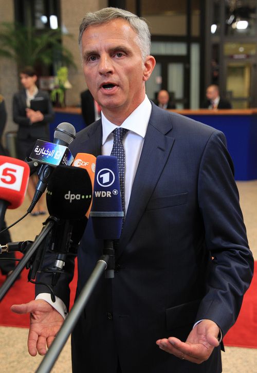 Swiss President and OSCE chairperson in office Didier Burkhalter talks with the media, after he met with EU foreign ministers, at the European Council building in Brussels, Monday, May 12, 2014. European Union foreign ministers are considering adding more people to its Ukraine sanctions list but are not expected to go beyond visa bans and asset freezes before the May 25 elections in the east European nation. (AP Photo/Yves Logghe)