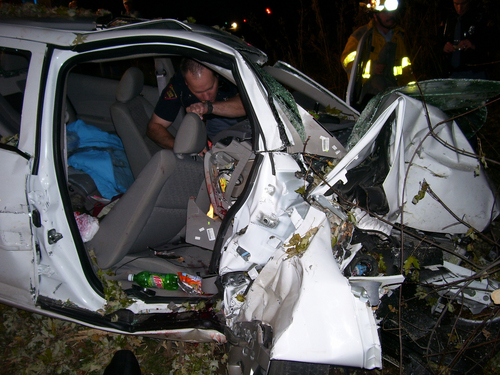 "In this Oct. 24, 2006 photo provided by the St. Croix County Sheriff's Office, police investigate the wreckage of a 2005 Chevrolet Cobalt that crashed in St. Croix County, killing Natasha Weigel, 18, and Amy Lynn Rademaker, 15, and injuring the 17-year-old driver, Megan Ungar-Kerns. The vehicle's ignition was found in the ""accessory"" position and the air bags didn't deploy. General Motors' recent recall of 2.6 million small cars, including the 2005 Cobalt, has shed light on an unsettling fact: Air bags might not always deploy when drivers -- and federal regulators -- expect them to. (AP Photo/St. Croix County Sheriff's Office)"