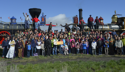 Scott Sommerdorf   |  The Salt Lake Tribune The Chinese community honored Chinese immigrants who built the railroad from the west by posing more than three busloads of people into a photo at the Golden Spike National Monument on the 145th commemoration of the completion of the transcontinental railroad on Saturday.