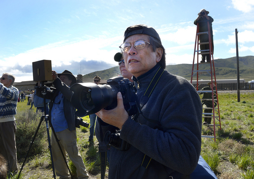 Scott Sommerdorf   |  The Salt Lake Tribune Photographer Corky Lee came from New York to make a photo that he hoped would rectify the history of honoring the Chinese immigrants who built the railroad from the west. Chinese workers were not represented in the original Golden Spike photograph. The Chinese community took over 150 people to the Golden Spike National Monument for the 145th commemoration of the completion of the transcontinental railroad, Saturday, May 10, 2014.