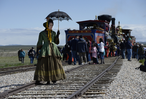 Scott Sommerdorf   |  The Salt Lake Tribune Katie Breitenbeker of Brigham City walks along the tracks in a period costume. The Chinese community honored Chinese immigrants who built the railroad from the west by taking more than three busloads of people to the Golden Spike National Monument for the 145th commemoration of the completion of the transcontinental railroad, Saturday, May 10, 2014.