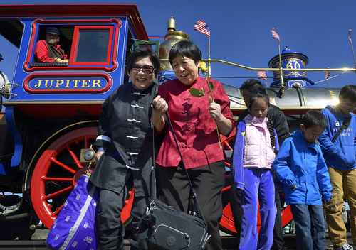 Scott Sommerdorf   |  The Salt Lake Tribune Margaret Yee, left, and Su Lin Chen, laugh after having taken a photo with family members at the Golden Spike re-enactment on Saturday. Yee and Chen are decendants of workers who built the railroad.