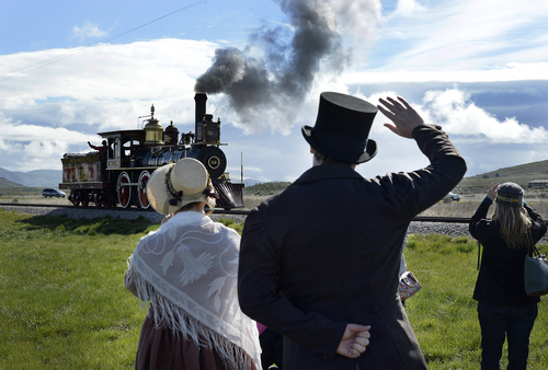 Scott Sommerdorf   |  The Salt Lake Tribune Actors in period costumes greet one of the locomotives used in the Golden Spike re-enactment ceremony. The Chinese community honored Chinese immigrants who built the railroad from the west by taking more than three busloads of people to the Golden Spike National Monument for the 145th commemoration of the completion of the transcontinental railroad on  Saturday.