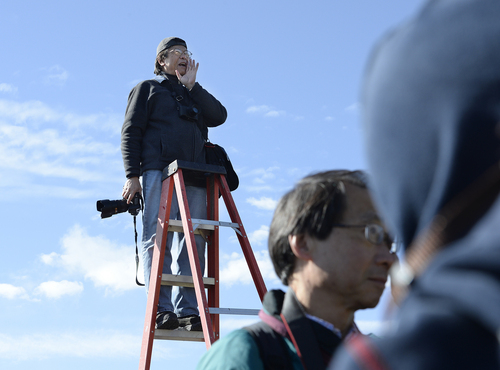 Scott Sommerdorf   |  The Salt Lake Tribune Photographer Corky Lee shouts to the Chinese community posing near the Golden Spike re-enactment ceremony as he makes a photo of them to honor Chinese immigrants who built the railroad from the west. The community took more than three busloads of people to the Golden Spike National Monument for the 145th commemoration of the completion of the transcontinental railroad, Saturday, May 10, 2014.