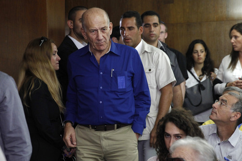 Israel's former Prime Minister Ehud Olmert at the Tel Aviv District Court in Israel, Tuesday, May 13, 2014. Olmert was sentenced on Tuesday to six years in prison for his role in wide-ranging bribery case, capping a stunning fall from grace for one of the most powerful men in the country. (AP Photo/Finbarr O'Reilly, Pool)