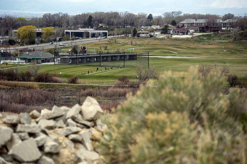 Chris Detrick  |  The Salt Lake Tribune Golfers use the driving range at Mulligans Golf and Games as seen from the undeveloped land across from the South Jordan Station at 10351 South Jordan Gateway Thursday April 3, 2014.