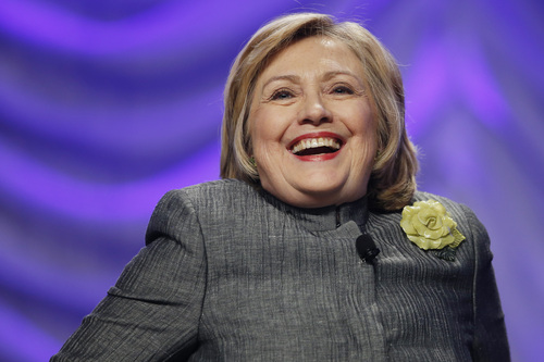 Former Secretary of State Hillary Rodham Clinton laughs while answering a question at the 2014 National Council for Behavioral Health Conference at Gaylord National Resort and Convention Center at National Harbor, Md., Tuesday, May 6, 2014. Clinton spoke about mental health, political, and social issues during her talk. (AP Photo/Charles Dharapak)