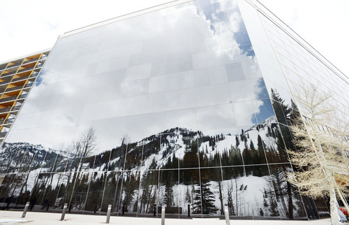 Steve Griffin  |  The Salt Lake Tribune   Ski runs are reflected in the windows of the Cliff Lodge at Snowbird ski resort in Little Cottonwood Canyon  Salt Lake City, Utah Monday, May 12, 2014.