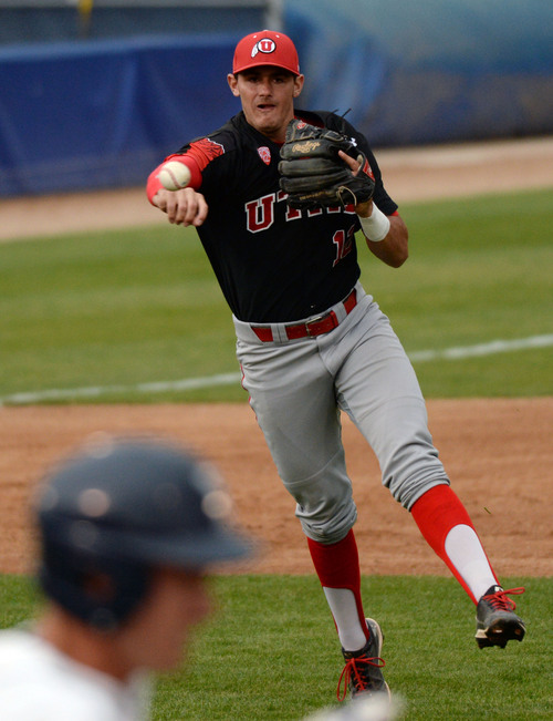 Steve Griffin     The Salt Lake Tribune   Utah third baseman Biss Larsen fires to first during baseball game against BYU at Miller Park on the campus of BYU in Provo, Utah Tuesday, May 6, 2014.