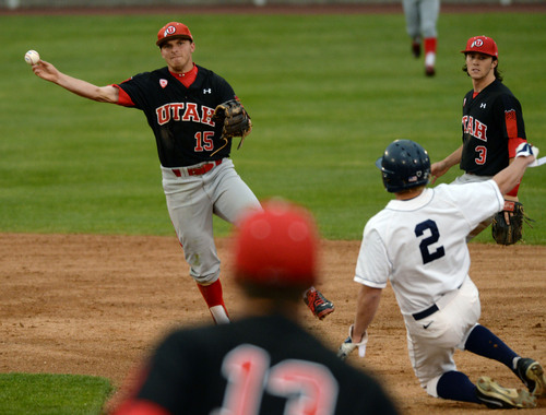 Steve Griffin     The Salt Lake Tribune   Utah shortstop Cory Hunt fires to first for a double play during baseball game against BYU at Miller Park on the campus of BYU in Provo, Utah Tuesday, May 6, 2014.