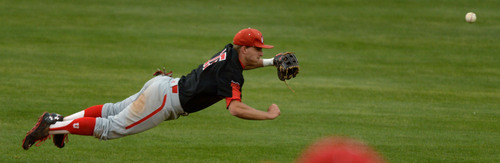 Steve Griffin     The Salt Lake Tribune   Utah shortstop Cory Hunt leaps for a line drive up the middle  during baseball game against BYU at Miller Park on the campus of BYU in Provo, Utah Tuesday, May 6, 2014.