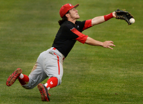 Steve Griffin     The Salt Lake Tribune   Utah second baseman Kody Davis gets his mitt on the ball but can't come up with the diving catch during baseball game against BYU at Miller Park on the campus of BYU in Provo, Utah Tuesday, May 6, 2014.