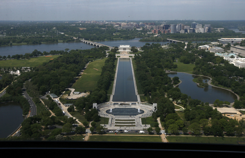 The Lincoln Memorial, rear, and the National World War II Memorial are seen from the 500-foot level of the Washington Monument in Washington, Monday, May 12, 2014, after a ceremony celebrated its re-opening. The monument, which sustained damage from an earthquake in August 2011, reopened to the public today. (AP Photo)