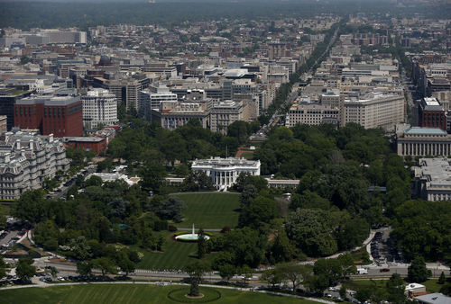 The South Lawn and the White House are seen from the 500-foot level of the Washington Monument in Washington, Monday, May 12, 2014, as it re-opens. The monument, which sustained damage from an earthquake in August 2011, reopened to the public today. (AP Photo)