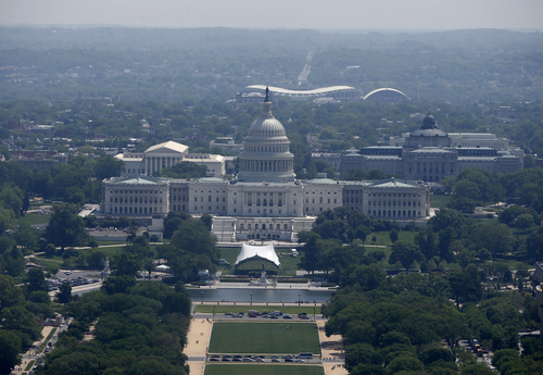 RFK Memorial Stadium is visible behind the U.S. Capitol from the 500-foot level of the Washington Monument in Washington, Monday, May 12, 2014, as it re-opens. The monument, which sustained damage from an earthquake in August 2011, reopened to the public today. (AP Photo)