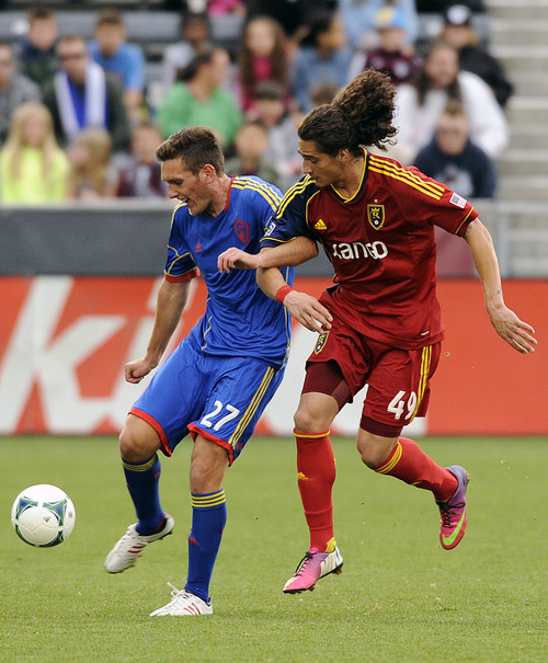 Colorado Rapids defender Shane O'Neill, left, of Ireland, and Real Salt Lake forward Devon Sandoval, right, fight for the ball in the first half of an MLS soccer game in Commerce City, Colo., on Saturday, April 6, 2013. The Rapids won 1-0. (AP Photo/Chris Schneider)