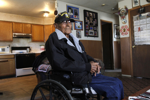 Navajo Code Talker Tom Jones is seen, Wednesday, Nov. 14, 2014, during an interview at his home in Hogback, N.M. The Navajo Nation said Jones died Monday May 12, 2014 at a Farmington hospital after a battle with pneumonia and other medical conditions. He was 89.  (AP Photo/The Daily Times, Jon Austria)