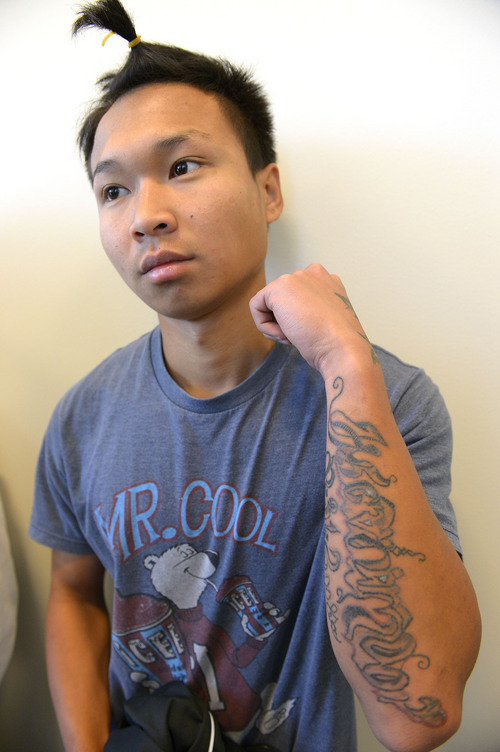Leah Hogsten  |  The Salt Lake Tribune Hser Ner Moo's brother, Sunday Moo shows off his new tattoo of his his sister's Hser Ner Moo's name outside the courtroom where her killer Esar Met was sentenced.  Esar Met, a 27-year-old Burmese refugee was sentenced to life without the possibility of parole on Wednesday, May 14, 2014 by 3rd District Judge Judith Atherton for killing  7-year-old Hser Ner Moo at his South Salt Lake apartment in 2008.