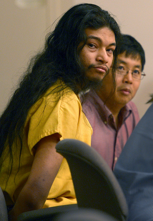 "Leah Hogsten  |  The Salt Lake Tribune Esar Met, a 27-year-old Burmese refugee, looks at his victim's family during his sentencing hearing. Met was sentenced to life without the possibility of parole on Wednesday, May 14, 2014 by 3rd District Judge Judith Atherton for killing a 7-year-old neighbor girl at his South Salt Lake apartment in 2008. Met continued to maintain his innocence during the hearing. ""I didn't kill that girl and I don't know who killed that girl,"" Met told the judge, referring to his victim, Hser Ner Moo."