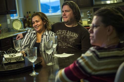 Chris Detrick  |  The Salt Lake Tribune Sil Hoggan, Daren Hoggan and Desi Parker talk during a Childless Mormon Support dinner Friday May 9, 2014.
