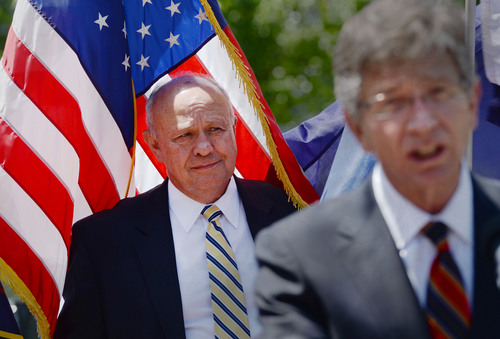 Steve Griffin  |  The Salt Lake Tribune  Lane Beattie, president and CEO of the Salt Lake Chamber of Commerce, left, listens as Richard Nelson, president and CEO of the Utah Technology Council, speaks during a rally calling for Congress to enact immigration reform. The group of leaders held a press conference at the State Capitol in Salt Lake City, one of six press conferences happening at the same time in six Western states Tuesday, May 13, 2014.