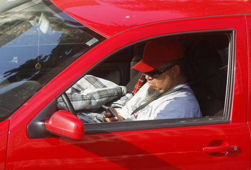 Utah has banned texting while driving, and several other phone-related activities behind the wheel. (AP Photo/Damian Dovarganes)