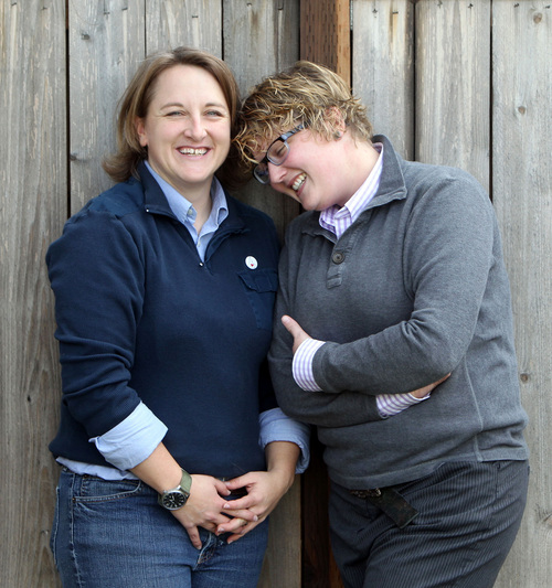 """FILE - In this Nov. 8, 2013 file photo, Amber Beierle, left, and Rachael Robertson pose for a photograph at their home in Boise, Idaho. They are one of four same-sex couples who are suing the state in federal court to challenge laws banning same-sex marriage and denying recognition to same-sex couples who married in other states. U.S. District Magistrate Judge Candy Dale ruled Tuesday evening, May 13, 2014, that Idaho's laws banning same-sex marriage unconstitutionally deny gay and lesbian citizens of their fundamental right to marry. Gov. C.L. """"Butch"""" Otter has already said he intends to appeal the case. (AP Photo/The Idaho Statesman, Joe Jaszewski, File)  LOCAL TV OUT (KTVB 7)"""