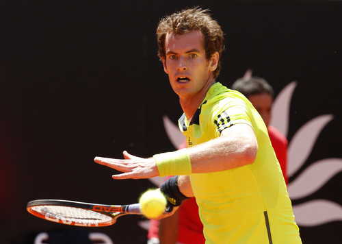 Britain's Andy Murray returns the ball to Spain's Marcel Granollers at the Italian open tennis tournament in Rome, Wednesday, May 14, 2014. (AP Photo/Riccardo De Luca)