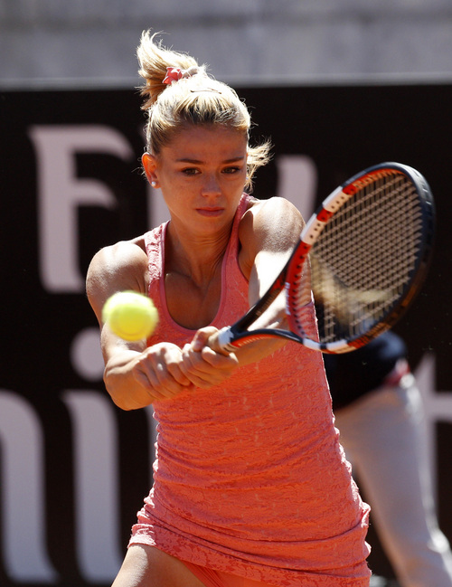Italy's Camila Giorgi returns the ball to United States' Christina McHale at the Italian open tennis tournament in Rome, Wednesday, May 14, 2014. (AP Photo/Riccardo De Luca)