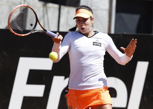 United States' Christina McHale returns the ball to  Italy's Camila Giorgi at the Italian open tennis tournament in Rome, Wednesday, May 14, 2014. (AP Photo/Riccardo De Luca)