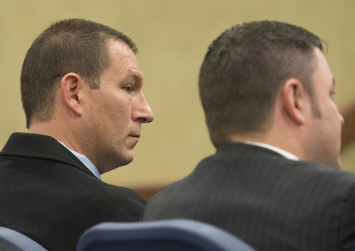 Rick Egan  |  The Salt Lake Tribune  John Coyle (left) and attorney Blake Hamilton, await the decision of the West Valley City civil service commission hearing, Thursday, May 15, 2014. The commission overturned Coyle's demotion and ordered the department to award him back pay.