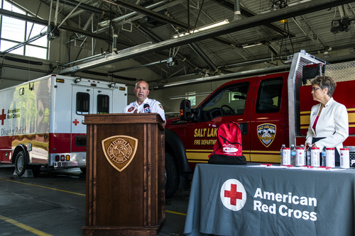 Chris Detrick  |  The Salt Lake Tribune Salt Lake City Fire Department Deputy Chief Brian Dale and American Red Cross Regional CEO Heidi Ruster speak during a press conference announcing the ìFire Hurts. Red Cross Helps.î initiative at Salt Lake City Fire Department Station 1on  Thursday.