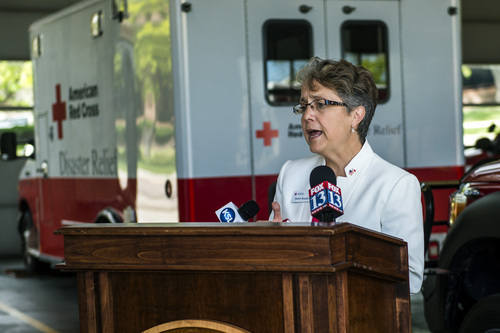 "Chris Detrick  |  The Salt Lake Tribune American Red Cross Regional CEO Heidi Ruster speaks during a press conference announcing the ""Fire Hurts. Red Cross Helps."" initiative at Salt Lake City Fire Department Station 1 Thursday May 15, 2014."
