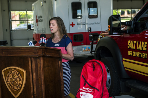 "Chris Detrick  |  The Salt Lake Tribune Americorps volunteer Rachel Krebs speaks during a press conference announcing the ""Fire Hurts. Red Cross Helps."" initiative at Salt Lake City Fire Department Station 1 Thursday May 15, 2014."