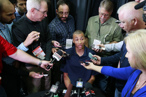 Dante Exum from Australia meets with reporters at the 2014 NBA basketball Draft Combine Thursday, May 15, 2014, in Chicago. Exum did not participate in his scheduled workout Thursday. (AP Photo/Charles Rex Arbogast)